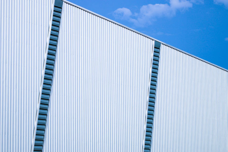 Architecture Blue Building Building Exterior Built Structure Clean Cloud - Sky Corrugated Day Low Angle View Metal Modern Nature No People Outdoors Pattern Reflection Side By Side Simplicity Sky Sunlight White Color