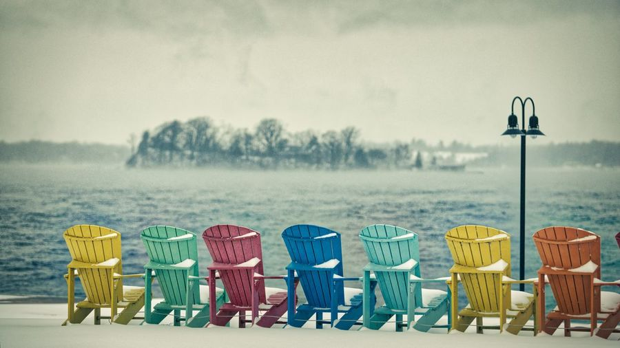 Pull Up a Chair Winter Colors Lake Chair Beach Sea Sand Multi Colored No People Outdoors Day Sky Nature Shades Of Winter