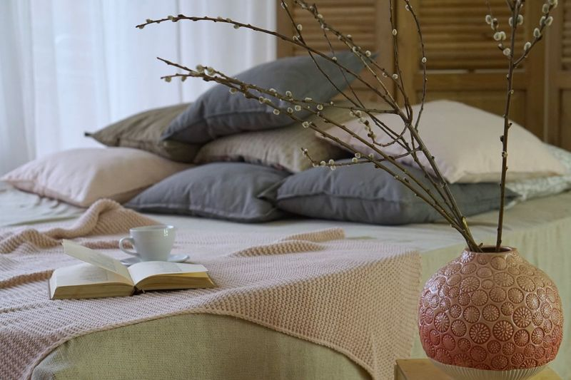 Decoration on table against bed