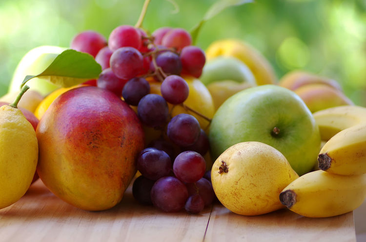 exotic fruit on table, green background Close-up Food Food And Drink Freshness Fruit Grape Green Color Healthy Eating Red Grape Ripe Table