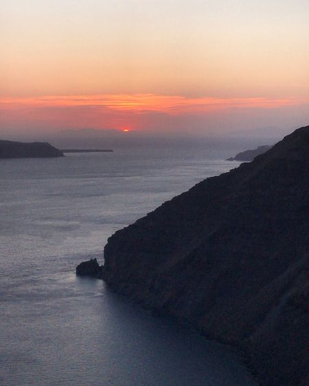 Sunset in Santorini Sunset Sky Water Sea Beauty In Nature Scenics - Nature Tranquil Scene Tranquility Nature Horizon Over Water Beach Land Horizon Orange Color Cloud - Sky Dramatic Sky Non-urban Scene Idyllic Romantic Sky No People