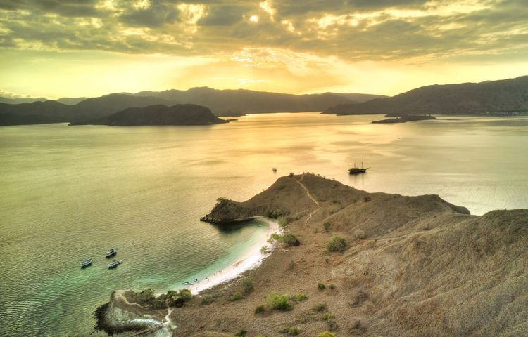 Komodo Island, Flores, Indonesia. Scenics - Nature Beauty In Nature Komodo Island Flores INDONESIA Tropical Climate Sunset Sky Tranquil Scene Tranquility No People Nature Cloud - Sky Idyllic Outdoors Drone Shot Aerial View Drone  Land Water Mountain Beach Mountain Range Non-urban Scene Coastline Rock Bay Sea