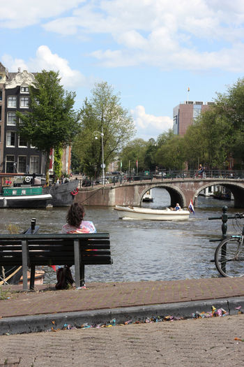 Amstel Amsterdam Amsterdam Canal Bench Romance Romantic Amsterdamcity Amsterdamse Grachten Architecture Boat City City Life Cloud - Sky Girl Real People River Water