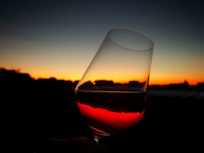 a romantic glas of wine Wine Wineglass Wine moments Sunset Sunset_collection Sunlight Sunset Silhouettes Sunsets Sunsetporn Sunsetlover Beauty In Nature Beautiful Nature_collection Water Alcohol Sunset Drink Wine Drinking Glass Champagne Cola Tonic Water Sky Liqueur Rose Wine Crystal Glassware Sommelier Winetasting