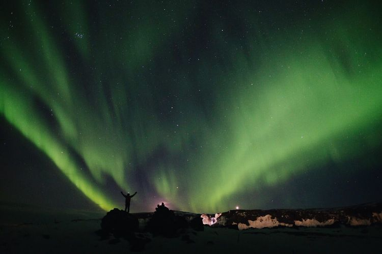 Low angle view of aurora polaris against sky at night