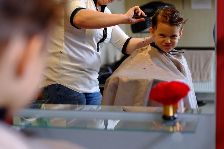 Funny child in hair salon