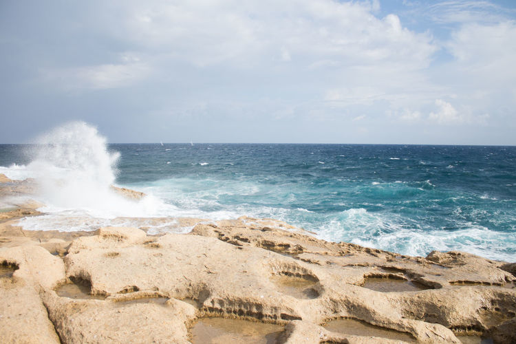 Sea Water Sky Horizon Horizon Over Water Beach Land Beauty In Nature Wave Motion Cloud - Sky Scenics - Nature Nature No People Sport Day Rock Aquatic Sport Idyllic Outdoors Power In Nature Breaking Travel Destinations