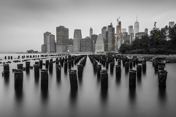 Black and white nyc manhattan from dock side brooklyn