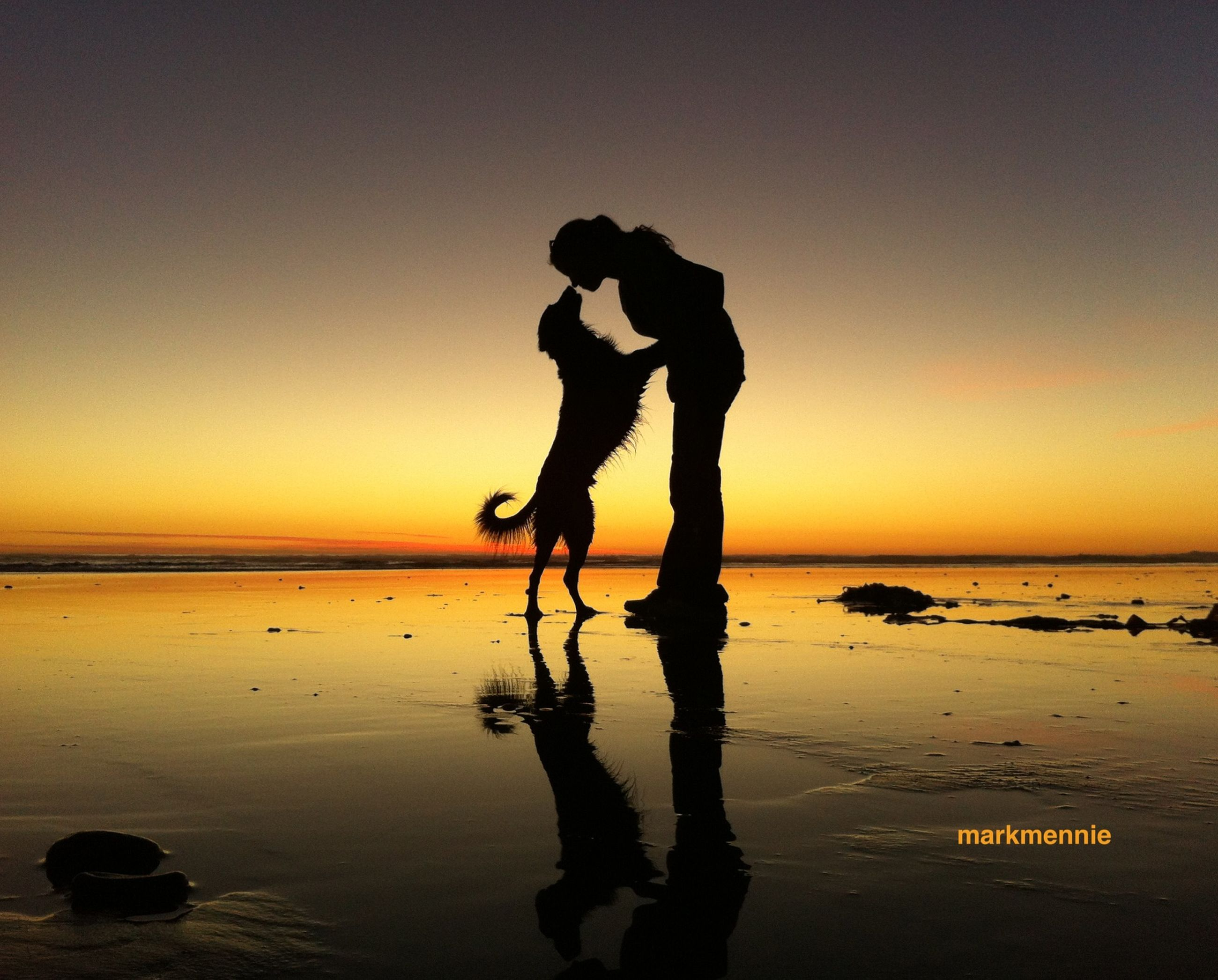 sea, sunset, water, beach, horizon over water, silhouette, lifestyles, leisure activity, shore, full length, men, standing, vacations, tranquility, sky, scenics, tranquil scene, reflection