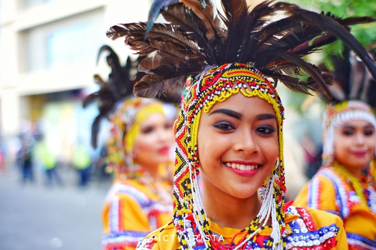 """Just a smile"" A portrait of a student during the Kadayawan sa Davao Festival, She is participating the Indak-Indak sa Kadalanan event and celebration. Fujifilm XT100 7artisans Randomphotos Composition Hobbyistphotographer Ndfiltered Philippines Landscapephotography Fuji Photographer Newbie Lensculture Streetphotographyworldwide Street_focus_on Streetphotography Streets_storytelling Streetsleaks Streetphotographycommunit Streetclassics EyeEm Selects City Young Women Headwear Portrait Beautiful Woman Smiling Headdress Multi Colored Happiness Headshot"