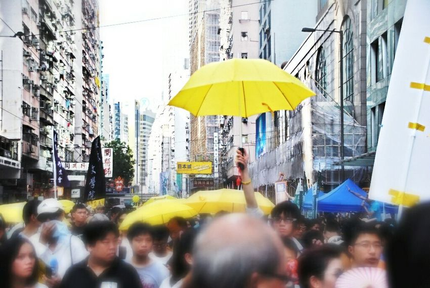 The Photojournalist - 2015 EyeEm Awards Yellow Umbrella at 71大遊行 Hongkonger Hello World