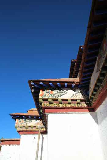 Roof decoration in Palcho Monastery, Gyantse, Tibet Architecture Astrology Sign Blue Building Exterior Built Structure Clear Sky Day No People Outdoors Palcho Monastery Rooftop Sky Tibetan Buddhist Temple Tibetan Culture Travel Destinations