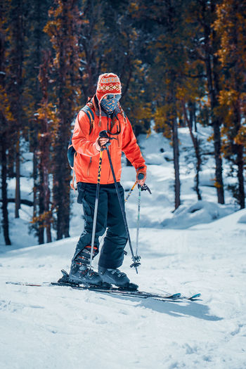 Full length of person skiing on snow covered land