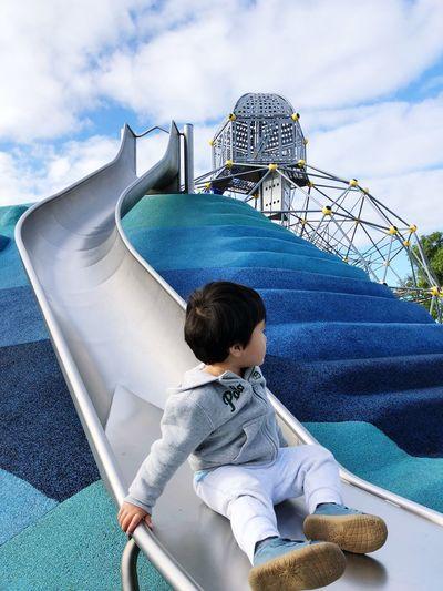Full length of boy on slide