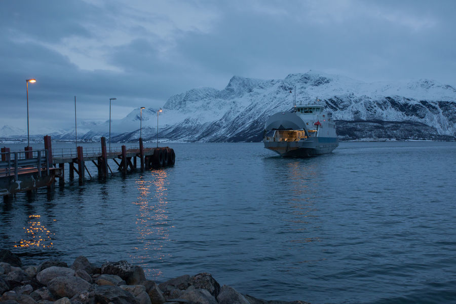 Remote pier at Svensby, Norway Arctic Astronomy Beauty In Nature Boat Cold Ferry Ferryboat Fjord Frozen Harbour Idyllic Jetty Mountain Non-urban Scene Norway Polar Night Portrait Quality Time Remote Snow Tranquil Scene Tranquility Tromsø Water Winter