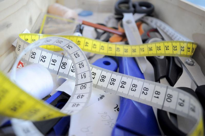 High angle view of measuring tape and work tools on table