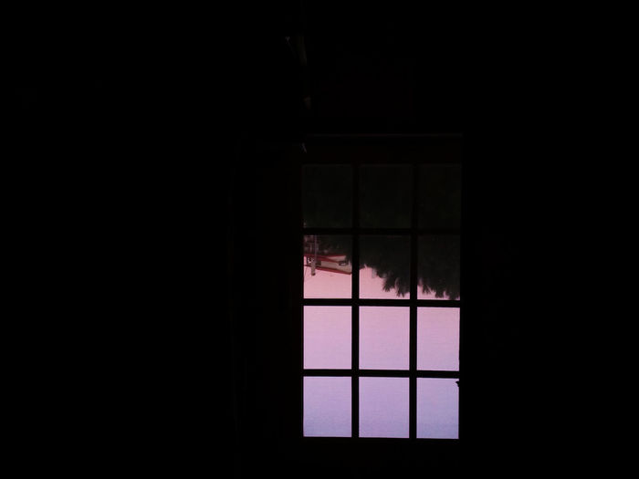 Close-up of window in dark room