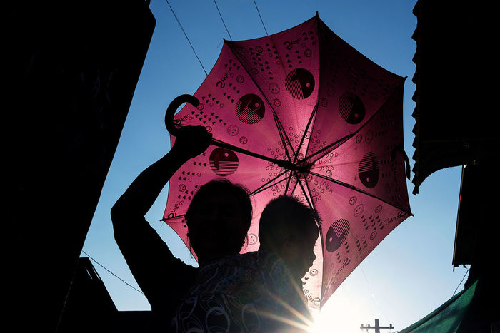 A woman with a pink umbrella in the lanes of Mawlamyine, South Myanmar. Silhouette Low Angle View Myanmar Mawlamyine Mawlamyaing Streetphotography Street Photography Fujifilm_xseries FUJIFILM X-T2 The Street Photographer - 2017 EyeEm Awards