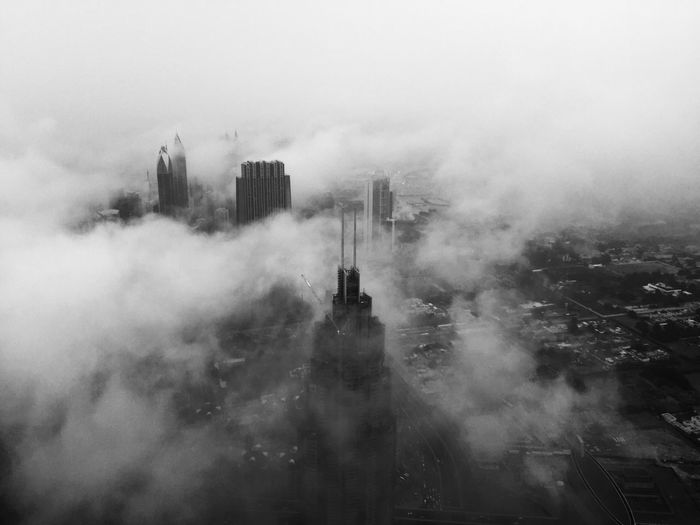 Aerial View Of Skyscraper In City During Foggy Weather