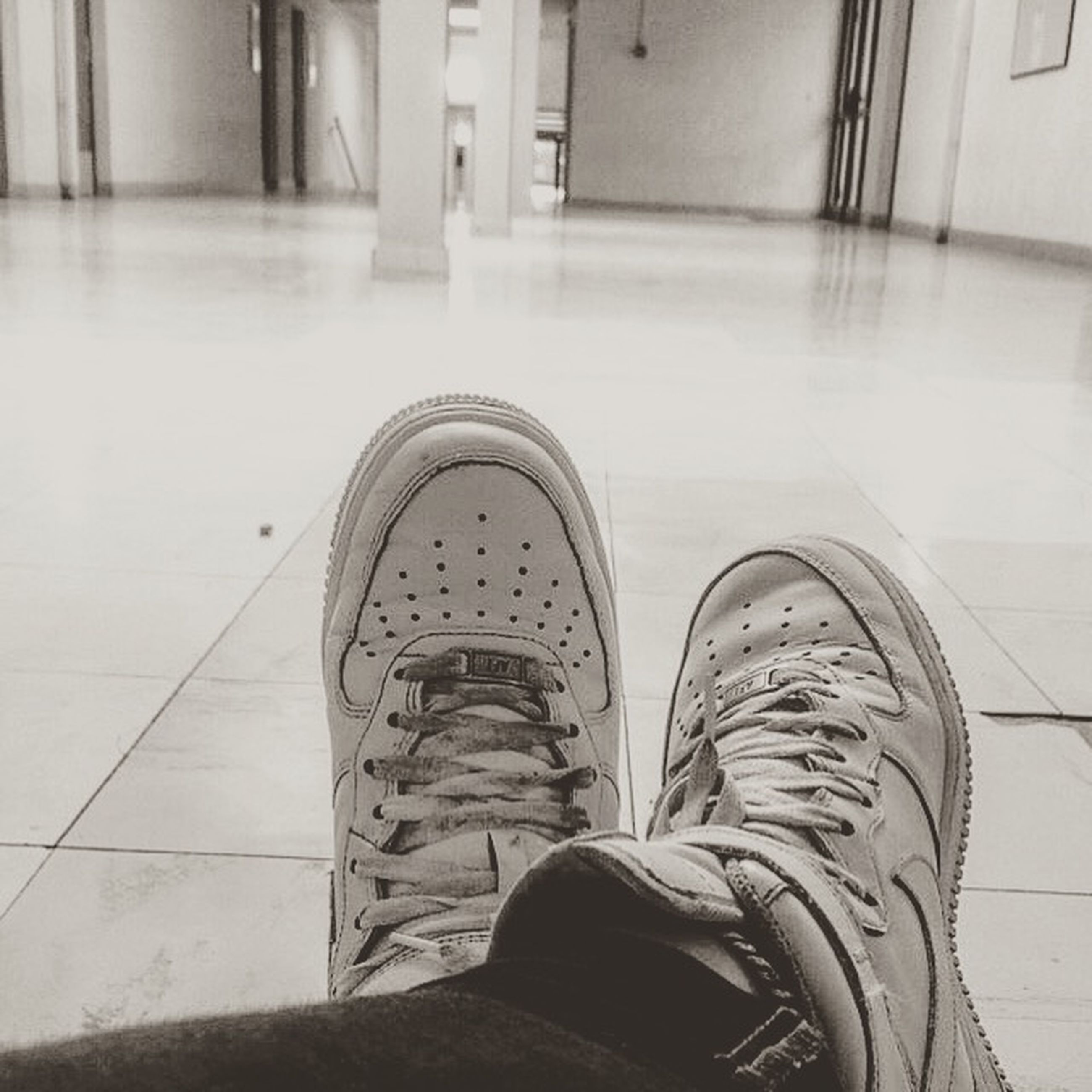 low section, shoe, person, personal perspective, indoors, footwear, flooring, standing, human foot, tiled floor, lifestyles, floor, men, high angle view, unrecognizable person, leisure activity, day