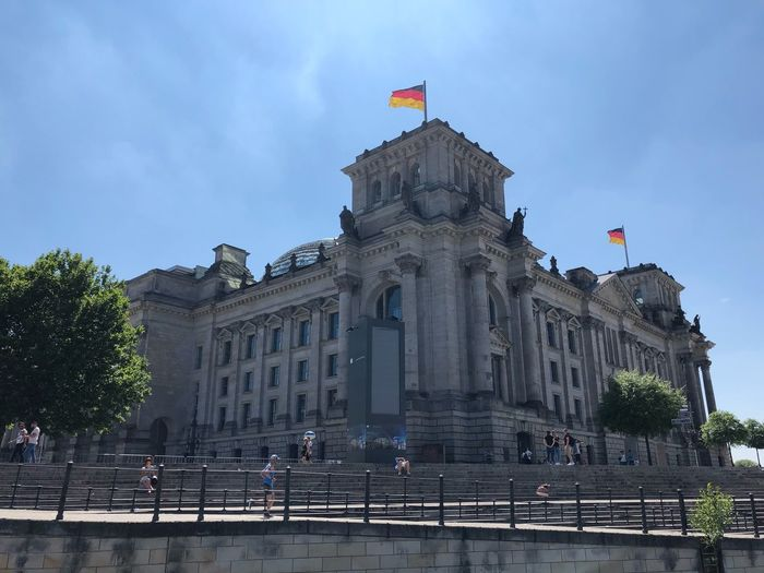 Blue Sky IPhone X IPhone X Photography Reichstag Berlin ReichstagBuilding Regierungsviertel Berlin Berlin Spree River Berlin Architecture Building Exterior Built Structure Flag Sky The Past History Travel Destinations Nature Patriotism Travel City Building Incidental People Tree Architectural Column Day Low Angle View Outdoors Government
