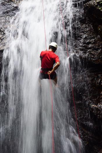 Red water splashing in waterfall