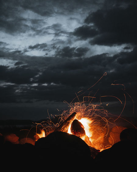 Fire against sky at night