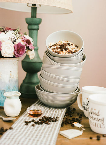 cereal bowls stacked with cereal inside top bowl. Breakfast Cereal Bowl Bowls Breakfast Time Close-up Coffe Coffee Bean Coffee Cup Day Flower Food Food And Drink Freshness Good Morning Indoors  No People Table