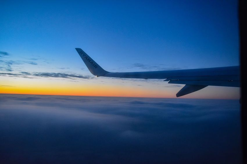 Flight with ryanair Airplane Transportation Sky Journey Flying Blue Airplane Wing Aerial View Mode Of Transport Beauty In Nature Sunset