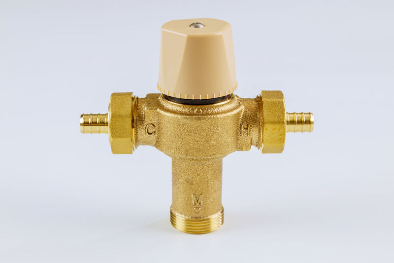 Close-up of faucet against white background
