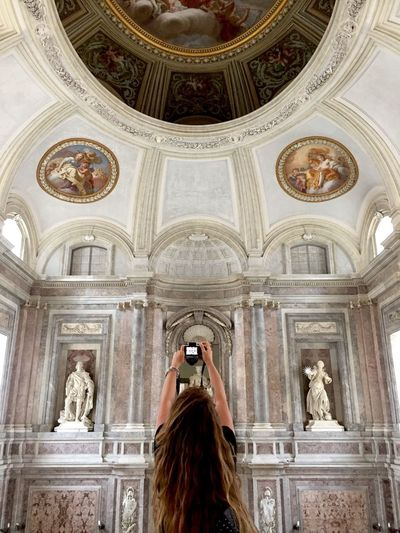 Architecture Discover Italy / With Ale One Person Real People Sculpture Statue Photographing Low Angle View Built Structure Day Architectural Column Photography Themes Indoors  Adult Adults Only People TheMinimals (less Edit Juxt Photography)