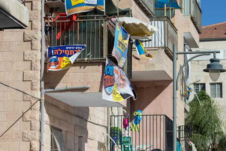 Low angle view of clothes drying outside building
