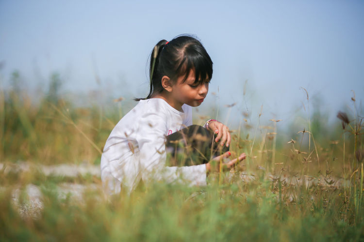 Child Nature Grass Land Field Hairstyle Casual Clothing Side View Girls Outdoors Leisure Activity Childhood Beauty In Nature Malaysia Alone Kidsphotography Photography Sky 17.62°
