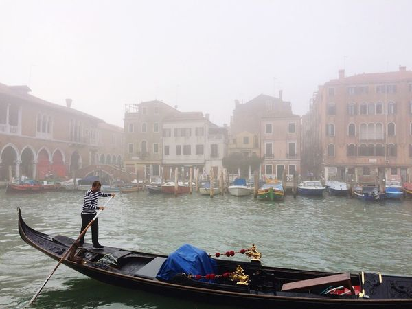 Gondola - Traditional Boat Cultures Transportation Gondolier Building Exterior Mode Of Transport Travel Destinations Canal Built Structure Travel Architecture Oar Water One Person Outdoors Day City Real People Rowing