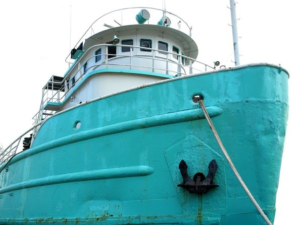 A vintage Chinese fishing boat is anchored in port Boat Corrosion Fishing Boat Green Color Old Rusty Hull Ship Vessel In Port Vintage Ship