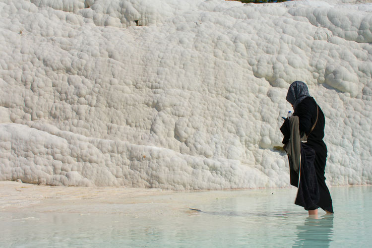 Pamukkale Pamukkale/Turkey Turkey Castle Blue White Terrace Muslim Woman Portrait One Person Water Real People Clothing Three Quarter Length Winter Adult Lifestyles Women Day Side View Cold Temperature Warm Clothing Waterfront Leisure Activity Nature Full Length Beauty In Nature Outdoors