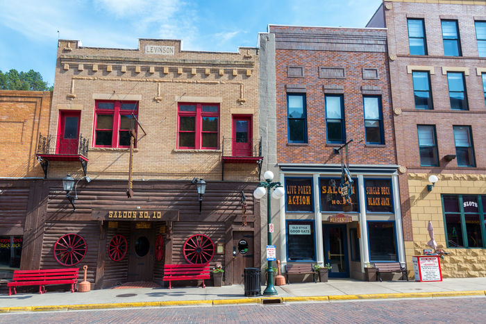 DEADWOOD, SD - AUGUST 26: Historic buildings in Deadwood, SD on August 26, 2015 Architecture Architecture Bar Black Hills Brick Building Exterior Built Structure Casino Deadwood  Downtown Historic Hotel Old West  Restaurant South Dakota Tavern  Tourism Tourists Town Travel Travel Destinations USA Western Wild West Window