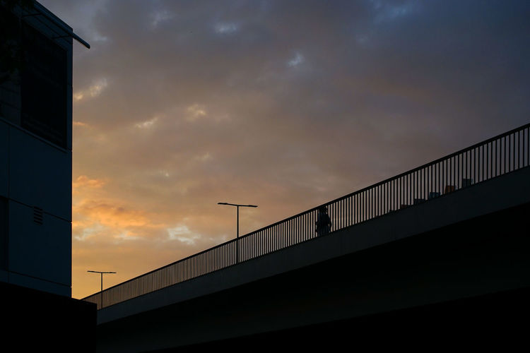 Low angle view of bridge against sky at sunset
