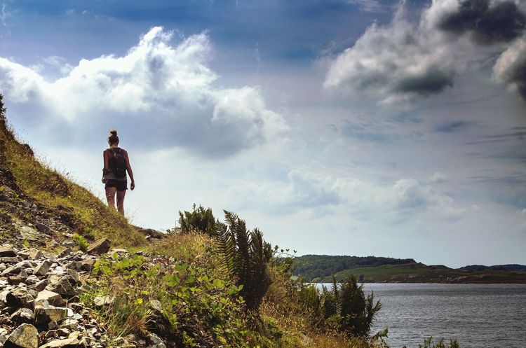 Rewild yourself. Wastwater Lake District Woman Adult Hiking Countryside Walks Nature Rewilding Outdoors Lake Clouds Sky Summer Active Lifestyle  Activewear Intrepid Plants Grass Lakeside Footpath Young Adult Stones Stonepath Wast Water