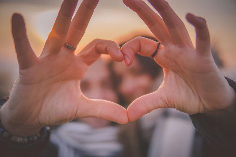 Couple forming heart shape