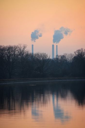Smoke Stack Industry Factory Pollution Air Pollution Emitting Cooling Tower Smoke Smoke - Physical Structure Reflection Fuel And Power Generation Built Structure Sunset Fumes Chimney Waterfront Industrial Building  Sky Water Ecosystem  Millennial Pink