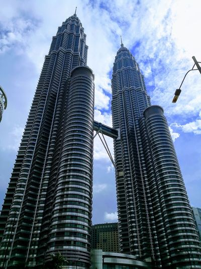 Petronas Twin Towers on a blue sky day Petronas Twin Towers Blueskies Clearweather Skyscraper Architecture Modern Low Angle View Built Structure Sky Travel Destinations