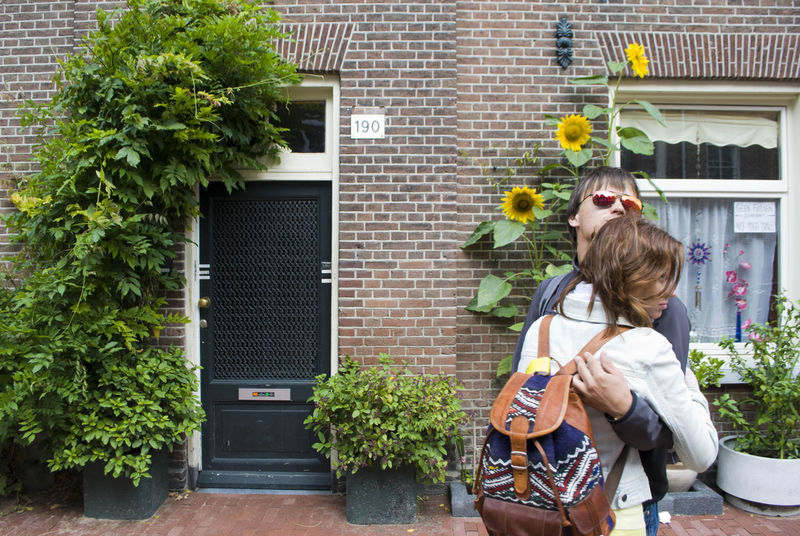 Amsterdam Amsterdam Streets Black Door Boy And Girl Cosy Couple Door Glasses Holland Hugs Human Body Part Inlove Love Mirror In Glasses Neetherlands Sunflower Two People Live For The Story