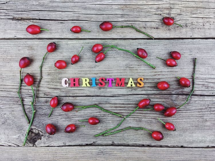 Christmas Colors Red Text Close-up Colored Background Colorful Day Food Food And Drink Freshness Fruit Indoors  Large Group Of Objects No People Red Single Word Studio Shot Text Western Script Wood - Material
