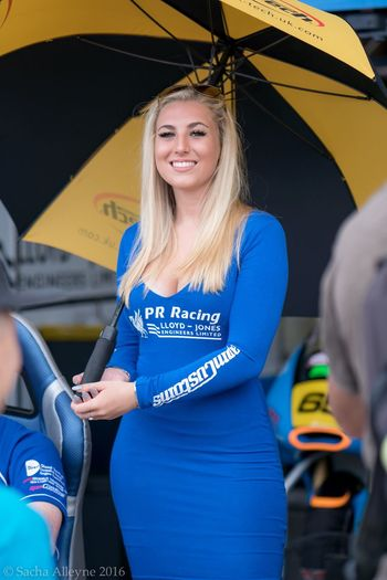 Smiling Young Women Young Adult Only Women Lifestyles One Woman Only One Young Woman Only Beautiful People Beauty Beautiful Woman Women Beautiful Britishsuperbikes Gridgirls Grid Girl Model Pitlane Standing People Happiness One Person Outdoors Day