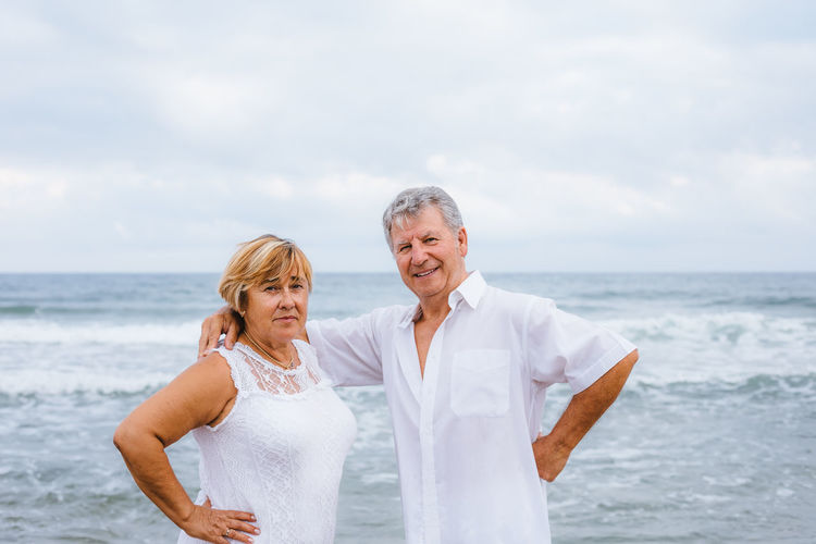 Sea Water Smiling Two People Standing Togetherness Adult Beach Men Senior Adult Women Males  Emotion Happiness Leisure Activity Sky Land Portrait Horizon Over Water Couple - Relationship Positive Emotion Wife