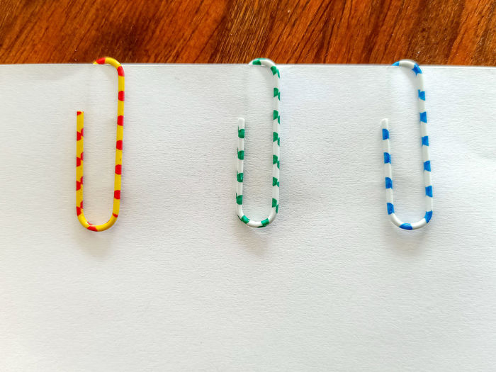 Close-up of paper clip on page at table