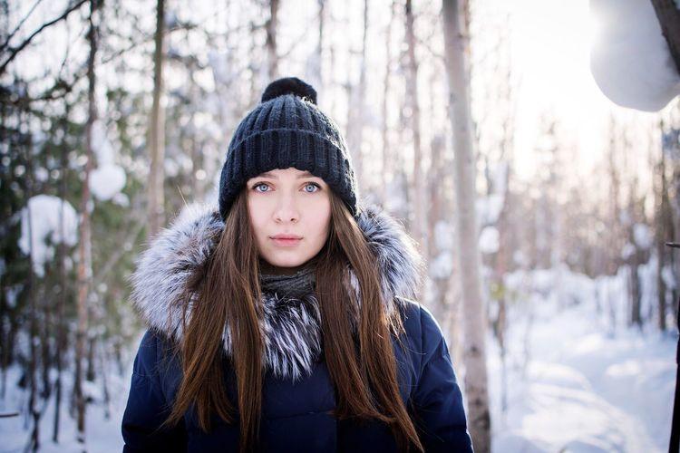 Portrait of beautiful woman in snow