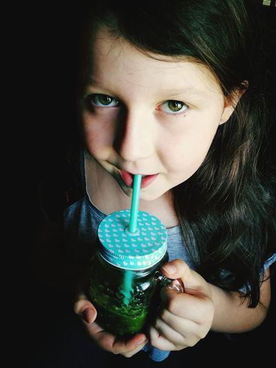 Portrait of girl drinking drink