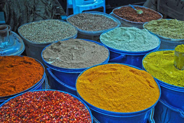 Colorful spices for sale at market stall